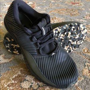 Adidas Men's tennis shoe size 8 black striped/camo